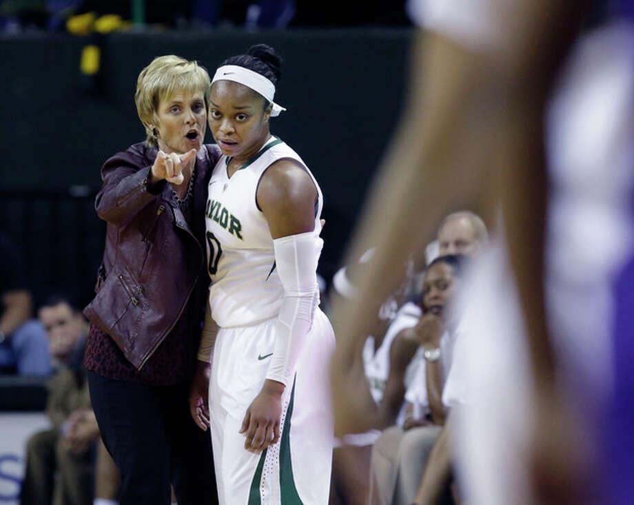 Baylor head coach Kim Mulkey, left, gives directions to Baylor guard Odyssey Sims (0) during the first half of an NCAA college basketball game against TCU, Saturday, Jan. 11, 2014, in Waco, Texas. (AP Photo/LM Otero) / AP