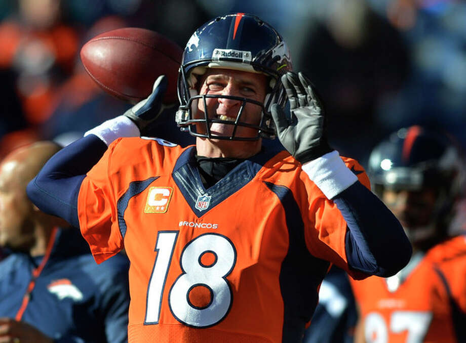 Denver Broncos quarterback Peyton Manning warms up before playing against the San Diego Chargers in an NFL AFC division playoff football game, Sunday, Jan. 12, 2014, in Denver. (AP Photo/Jack Dempsey) / FR42408 AP