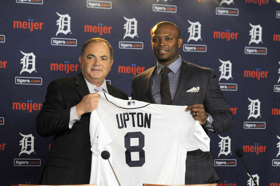 In this Jan. 20, 2016, photo, Detroit Tigers gewneral manager Al Avila, left, poses with new Tigers outfielder Justin Upton after announcing a six-year contract at Comerica Park in Detroit, Mich. (Steve Perez/Detroit News via AP) DETROIT FREE PRESS OUT; HUFFINGTON POST OUT; MANDATORY CREDIT