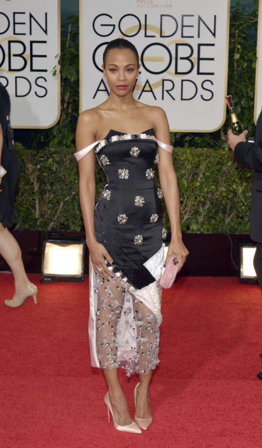 Zoe Saldana arrives at the 71st annual Golden Globe Awards at the Beverly Hilton Hotel on Sunday, Jan. 12, 2014, in Beverly Hills, Calif. (Photo by John Shearer/Invision/AP)