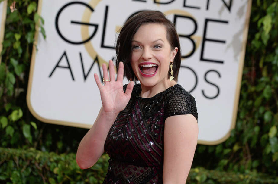 Elisabeth Moss arrives at the 71st annual Golden Globe Awards at the Beverly Hilton Hotel on Sunday, Jan. 12, 2014, in Beverly Hills, Calif. (Photo by Jordan Strauss/Invision/AP) / Invision