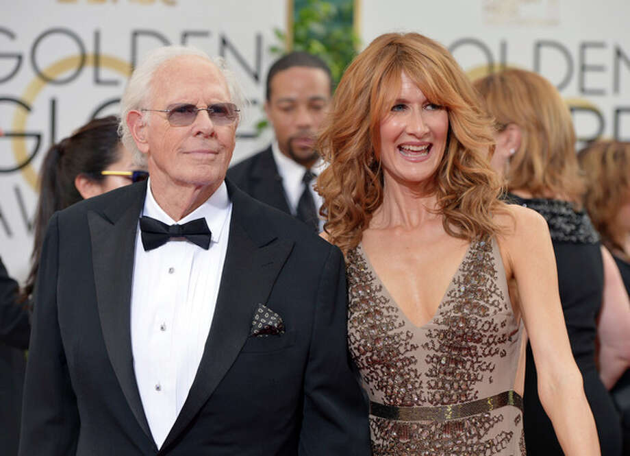 Bruce Dern, left, and Laura Dern arrive at the 71st annual Golden Globe Awards at the Beverly Hilton Hotel on Sunday, Jan. 12, 2014, in Beverly Hills, Calif. (Photo by John Shearer/Invision/AP) / Invision