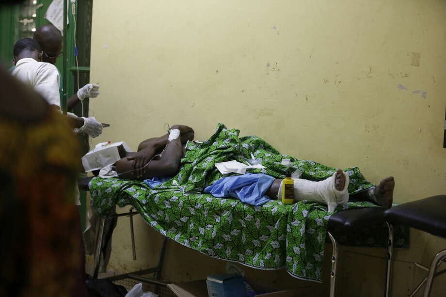 A victim of Saturday's gun attack at the Splendid Hotel receives treatment at a hospital in Ouagadougou, Burkina Faso, Sunday, Jan. 17, 2016. The overnight seizure of a luxury hotel in Burkina Faso's capital by al-Qaida-linked extremists ended Saturday when Burkina Faso and French security forces killed four jihadist attackers and freed more than 126 people, the West African nation's president said. (AP Photo/Sunday Alamba)