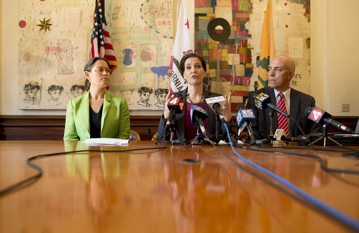 Oakland Mayor Libby Schaaf discusses Police Chief Sean Whent's resignation on Friday, June 10, 2016, in Oakland, Calif. Flanking her are Interim Police Chief Ben Fairow and City Administrator Sabrina Landreth.