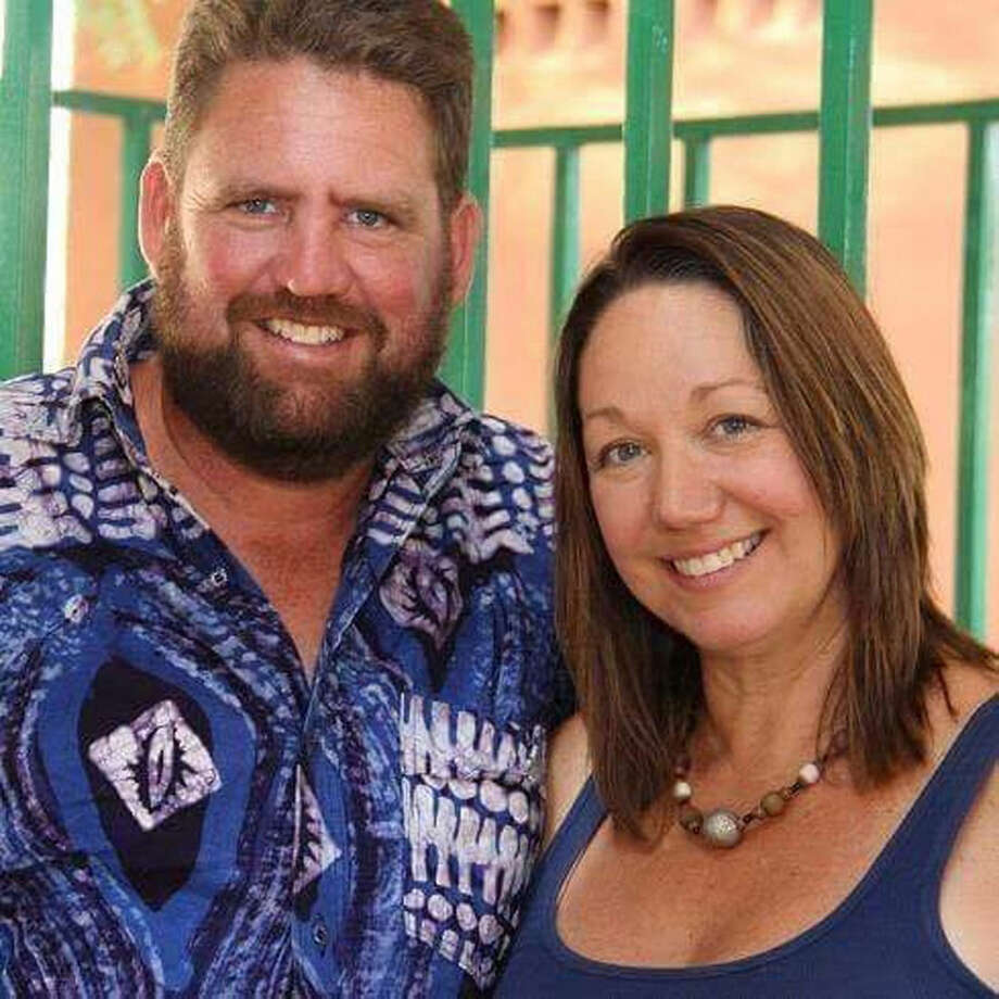 This photo provided by Carol Boyle shows Mike and Amy Riddering. Boyle said Riddering, 45, died in the Cappuccino Cafe, in Burkina Faso, where he was to meet a group that was going to volunteer at the orphanage and women's crisis center he ran with his wife, Amy. Riddering was in the cafe with a pastor, and when the attack started they ran in different directions, Boyle said, and it wasn't until a family friend found him in the morgue that they knew he was dead. At least 28 people died in the attack by fighters, which triggered a siege lasting more than 12 hours. (Carol Boyle via AP)