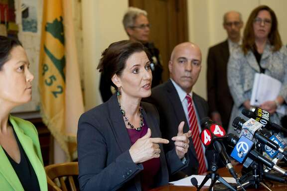 Oakland Mayor Libby Schaaf discusses Police Chief Sean Whent's resignation on Friday, June 10, 2016, in Oakland, Calif. At right is Interim Police Chief Ben Fairow.