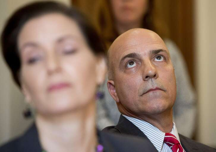 Interim Oakland Police Chief Ben Fairow listens during a press conference with Mayor Libby Schaaf, left, on Friday, June 10, 2016, in Oakland, Calif.