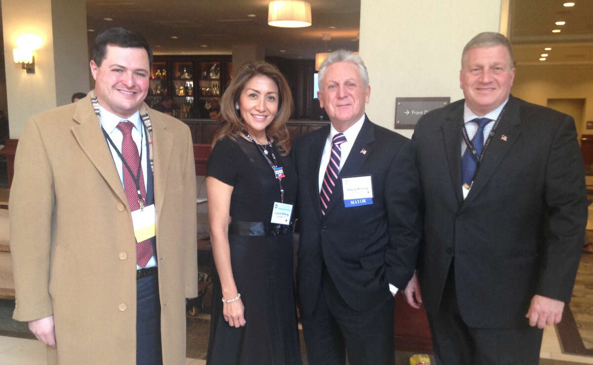Connecticut Mirror/Ana Radelat Trumbull First Selectman Tim Herbst, left, was among the Connecticut mayors and town leaders in Washington, D.C, to network with their peers and rub shoulders with the President. In this photo also are Lucia Rilling and Norwalk Mayor Harry Rilling and, at right,, Bristol Mayor Ken Cockayne.