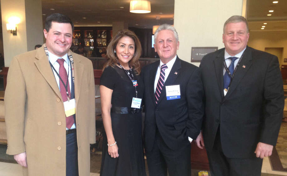 Connecticut Mirror/Ana RadelatTrumbull First Selectman Tim Herbst, left, was among the Connecticut mayors and town leaders in Washington, D.C, to network with their peers and rub shoulders with the President. In this photo also are Lucia Rilling and Norwalk Mayor Harry Rilling and, at right,, Bristol Mayor Ken Cockayne.
