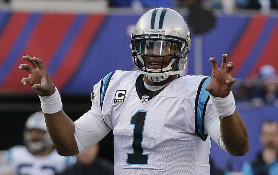 FILE - In this Dec. 20, 2015, file photo, Carolina Panthers quarterback Cam Newton calls an audible at the line of scrimmage during the second half of an NFL football game against the New York Giants, in East Rutherford, N.J. Arizona and Carolina play in the NFC Championship game on Sunday, Jan. 24, in Charlotte, N.C. (AP Photo/Julie Jacobson, File)