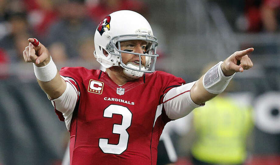 FILE - In this Jan. 3, 2016, file photo, Arizona Cardinals quarterback Carson Palmer (3) calls a play against the Seattle Seahawks during the first half of an NFL football game, in Glendale, Ariz. Arizona and Carolina play in the NFC Championship game on Sunday, Jan. 24, in Charlotte, N.C. (AP Photo/Ross D. Franklin)