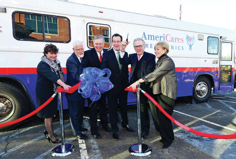 Hour photo /Erik TrautmannStella Smith of Quest Diagnostics, David Smith of Stamford Hospital, Stamford Mayor David Martin, CT Governor Dannel Malloy and Karen Gottlieb, Executive Director of AmeriCares Free Clinic attend a Ribbon Cutting and Opening Celebration for the AmeriCares Free Clinic of Stamford. The mobile clinic will serve low-income residents of Stamford and Darien ages 18 and older without health insurance. / (C)2013, The Hour Newspapers, all rights reserved