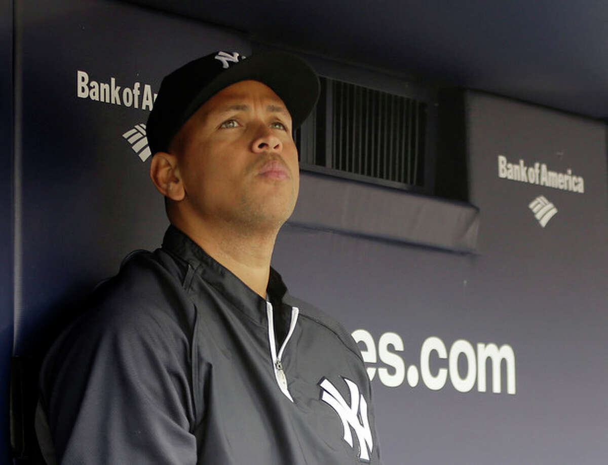 """FILE - In this April 13, 2013, file photo, New York Yankees' Alex Rodriguez sits in the dugout during a baseball game at Yankee Stadium in New York. Rodriguez sued Major League Baseball and Commissioner Bud Selig in a lawsuit, filed Thursday, Oct. 3, 2013, in New York State Supreme Court, accusing them of pursuing """"vigilante justice"""" as part of a """"witch hunt"""" designed to smear the character of the Yankees star and cost him tens of millions of dollars. (AP Photo/Kathy Willens, File)"""