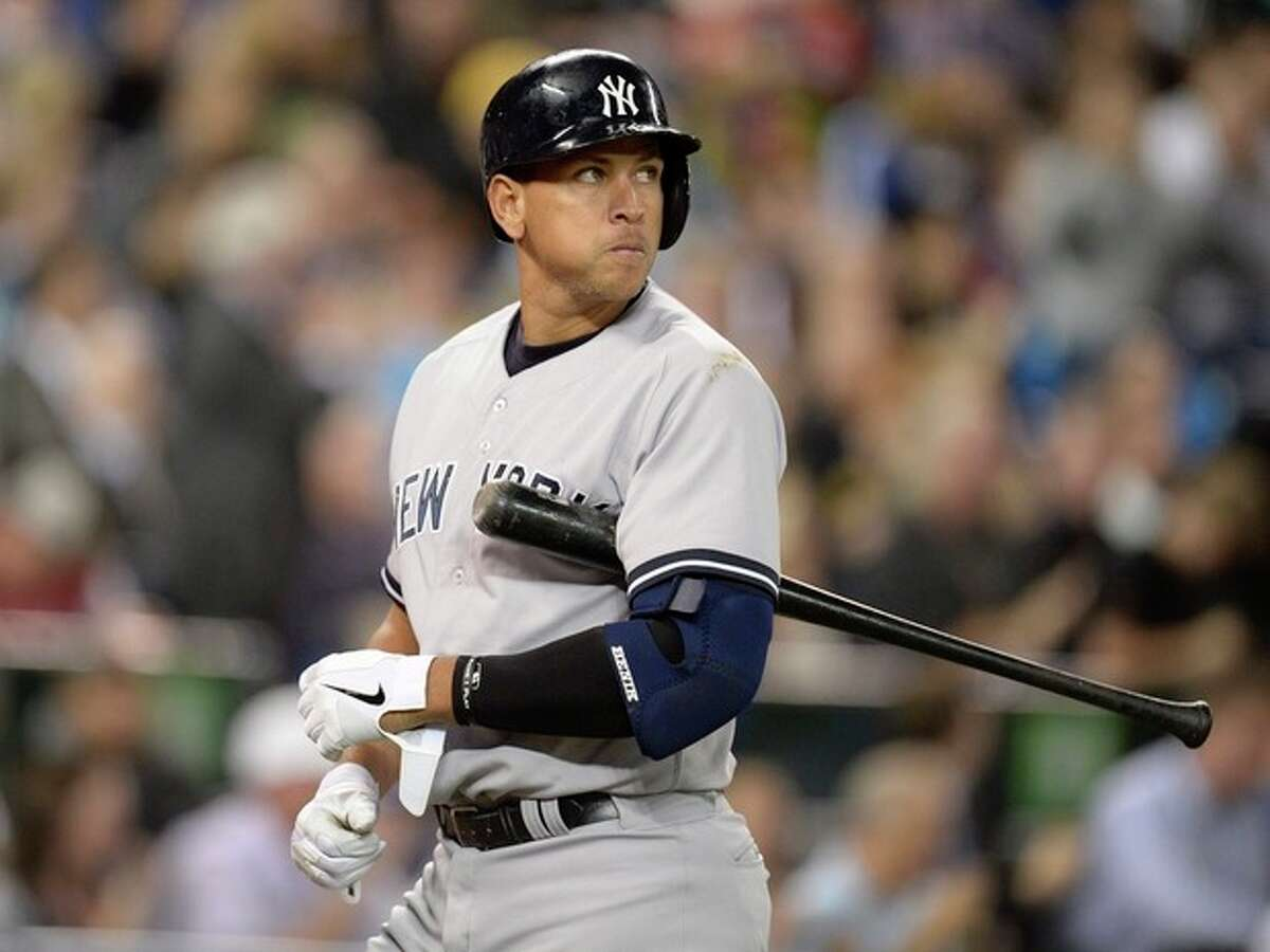 New York Yankees' Alex Rodriguez walks off the field after striking out against the Toronto Blue Jays during fifth inning MLB American League baseball action in Toronto, Tuesday, Sept.17, 2013. (AP Photo/The Canadian Press, Frank Gunn)
