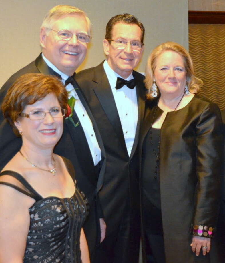 Mayor David Martin and his wife pose for a photo with Gov. Dannel P. Malloy and his wife, Cathy.