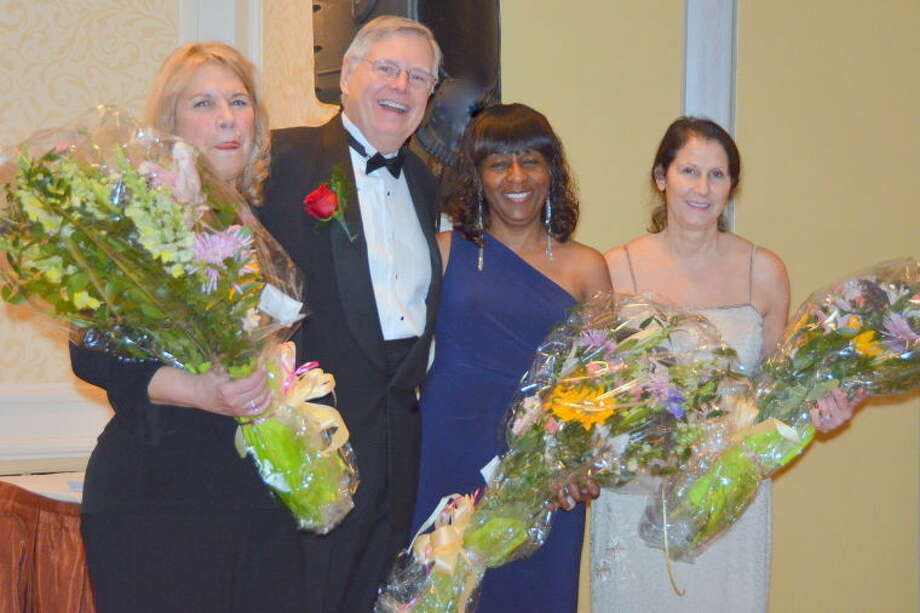Mayor David Martin presented floral bouquets to the three co-chairs of the Inaugural Ball. From left to right are: Claudia Silver, Gloria DePina and Philomena Mallozzi.