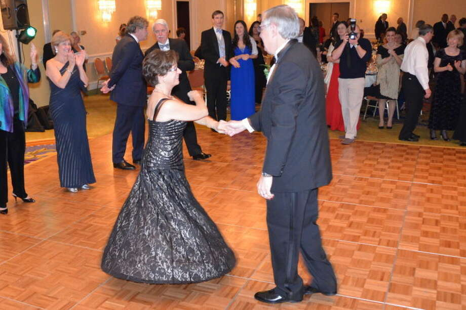 Mayor David Martin and his wife, Judy Martin, take to the dance floor during the ball.