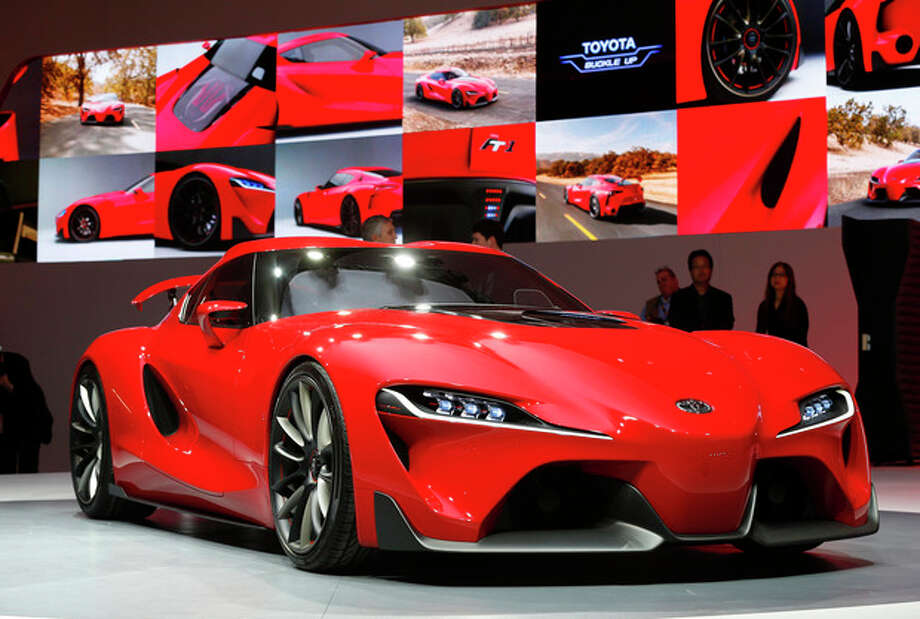 The Toyota FT-1 concept is unveiled during media previews during the North American International Auto Show in Detroit, Monday, Jan. 13, 2014. (AP Photo/Paul Sancya) / AP