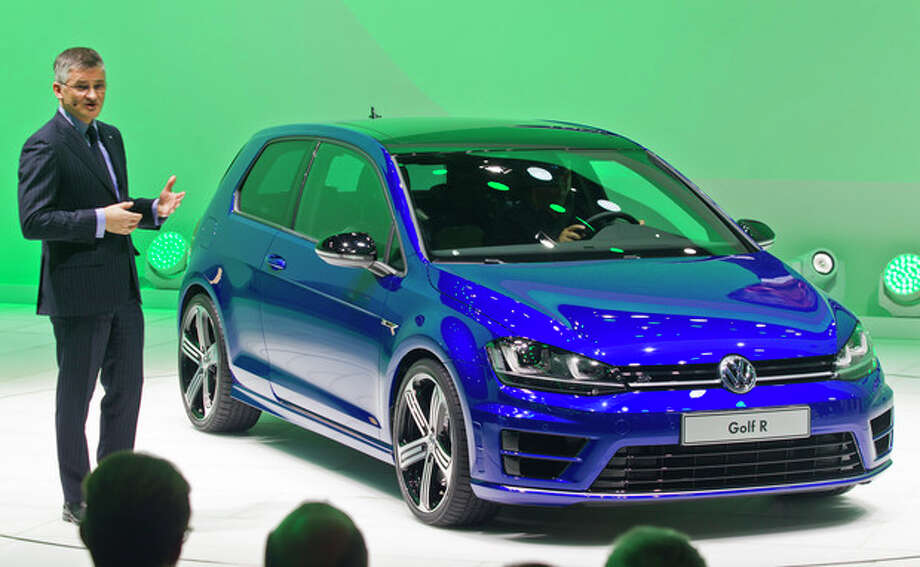 Michael Horn, incoming President and CEO of Volkswagen of America, speaks about the new Golf R hatchback, Monday, Jan. 13, 2014, at the North American International Auto Show in Detroit, Mich. (AP Photo/Tony Ding) / FR143848 AP
