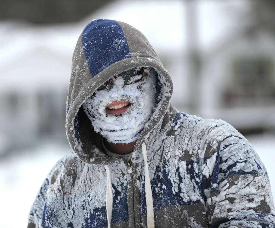 Michael Rainey got his face full of snow after tubing down the hill along Broad Street in Bristol, Tennessee on Friday, Jan. 22, 2016. The morning snow added to the snow from the Wednesday snow storm that came through the area. (Earl Neikirk/Bristol Herald Courier via AP)