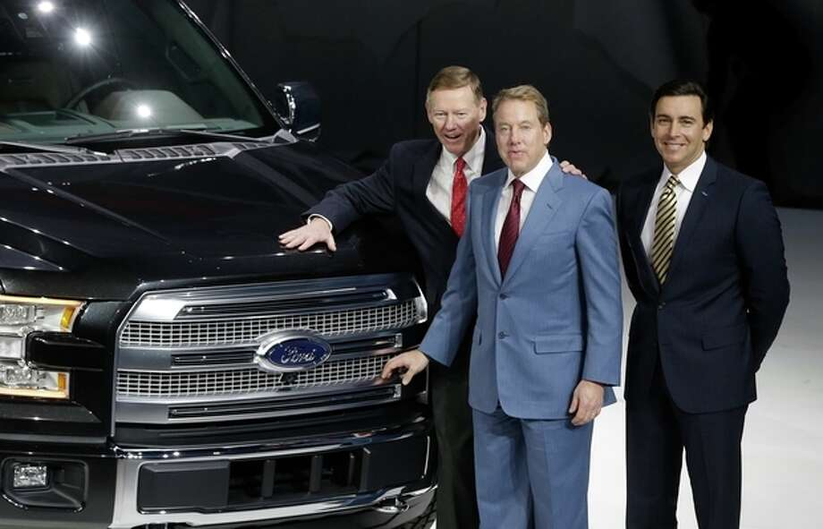 Alan Mulally, president and CEO of the Ford Motor Co., left, executive chairman Bill Ford, center, and COO Mark Fields stand next to the new Ford F-150 truck at the North American International Auto Show in Detroit, Monday, Jan. 13, 2014. (AP Photo/Carlos Osorio) / AP