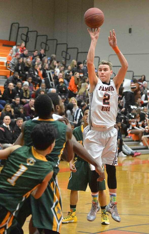 Hour Photo/Alex von Kleydorff Trinity Catholic at Stamford basketball