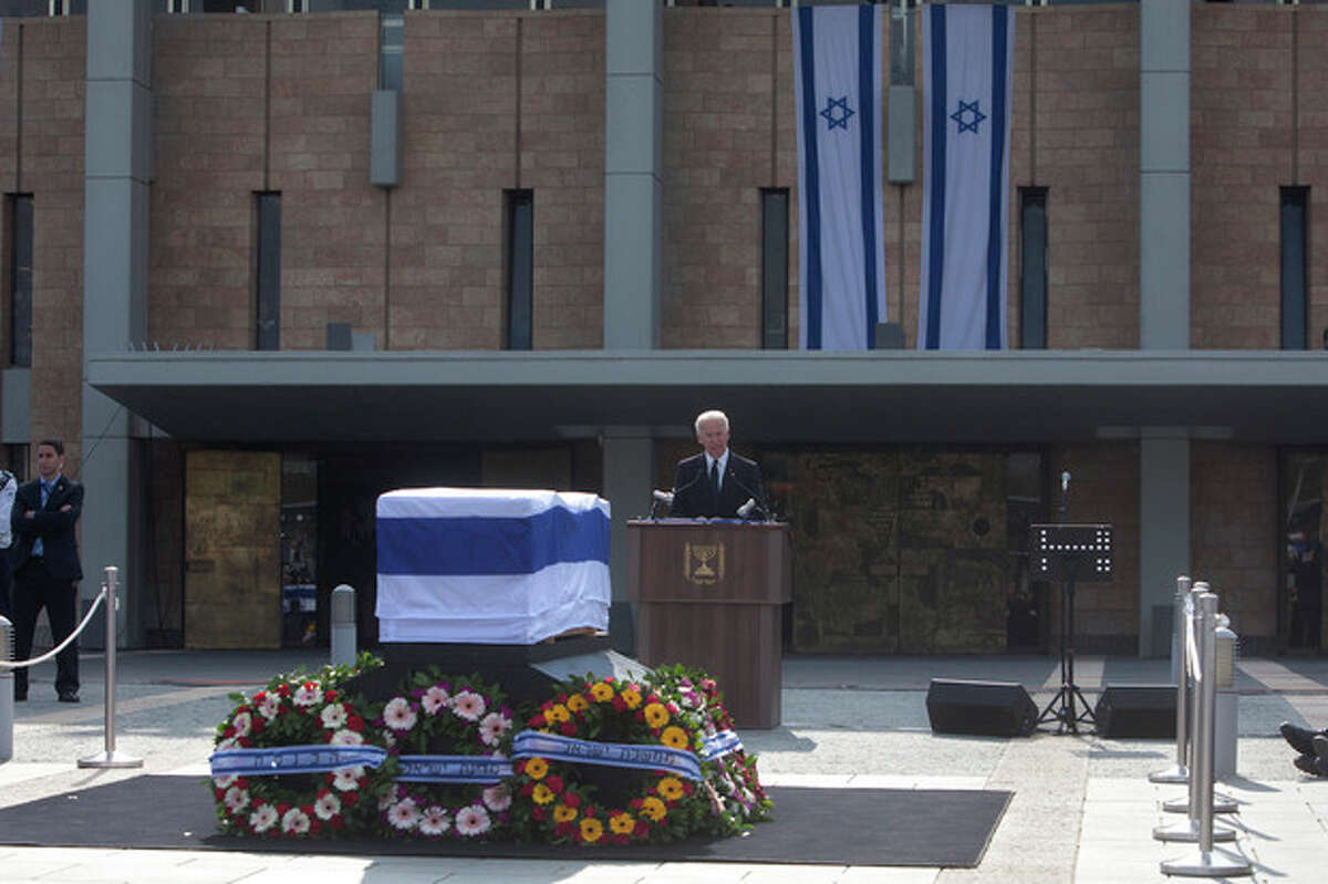 U.S. Vice President Joe Biden delivers a speech next to the coffin of late Israeli Prime Minister Ariel Sharon outside the Knesset, Israel's Parliament, in Jerusalem, Monday, Jan. 13, 2014. Israel is holding a state memorial ceremony for the former Prime Minister Ariel Sharon at the country's parliament building. Monday's official ceremony in the Knesset in Jerusalem will be followed by a private burial on the family's desert ranch in southern Israel. (AP Photo/Sebastian Scheiner)