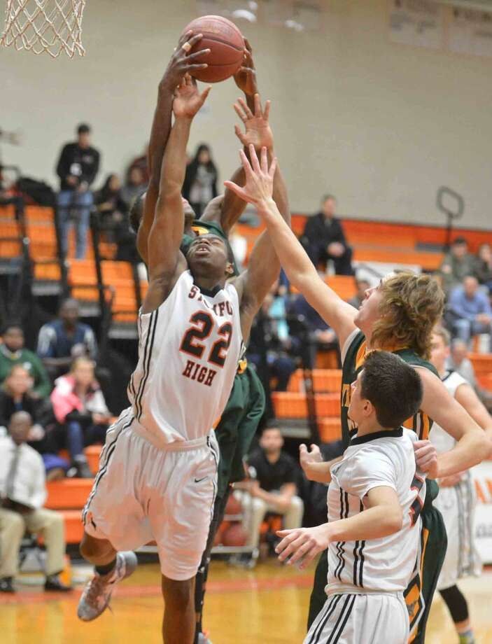 Hour Photo/Alex von Kleydorff Trinity at Stamford Boys basketball