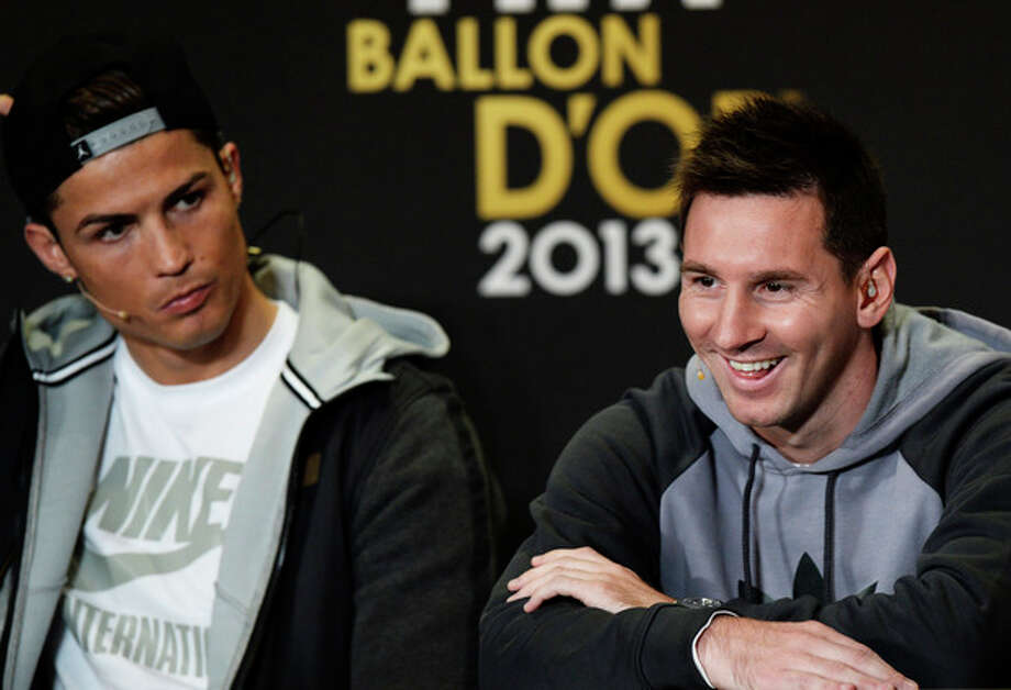 Cristiano Ronaldo of Portugal, left, and Lionel Messi of Argentina, right, nominees for the Men's World Soccer Player of the year, answer journalists questions during a press conference at the FIFA Ballon d'Or awarding ceremony in Zurich, Switzerland, Monday, Jan. 13, 2014. (AP Photo/Keystone,Steffen Schmidt) / KEYSTONE