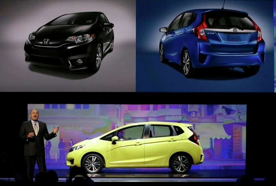 American Honda Motor Co., Executive Vice President John Mendel unveils the 2015 Honda Fit at the North American International Auto Show in Detroit, Monday, Jan. 13, 2014. (AP Photo/Carlos Osorio) / AP
