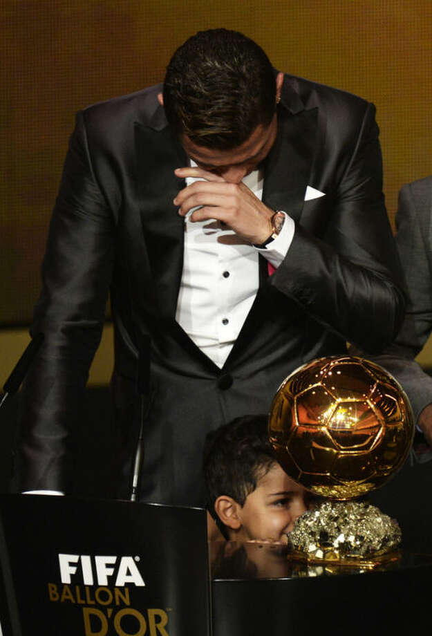 Cristiano Ronaldo of Portugal cries as he is awarded the prize for the FIFA Men's soccer player of the year 2013 at the FIFA Ballon d'Or 2013 gala at the Kongresshaus in Zurich, Switzerland, Monday, Jan. 13, 2014. (AP Photo, Keystone/Steffen Schmidt)