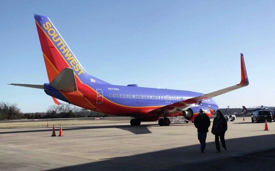 Southwest Airlines Flight 4013 sits at the M. Graham Clark Downtown Airport in Hollister, Mo., Monday, Jan. 13, 2014. The plane was supposed to land at the nearby Branson Airport on Sunday evening, but instead landed at Clark Airport, also known as Taney County Airport, which has a much shorter runway than at Branson, about 7 miles away. (AP Photo/Springfield News-Leader, Valerie Mosley) / Springfield News-Leader