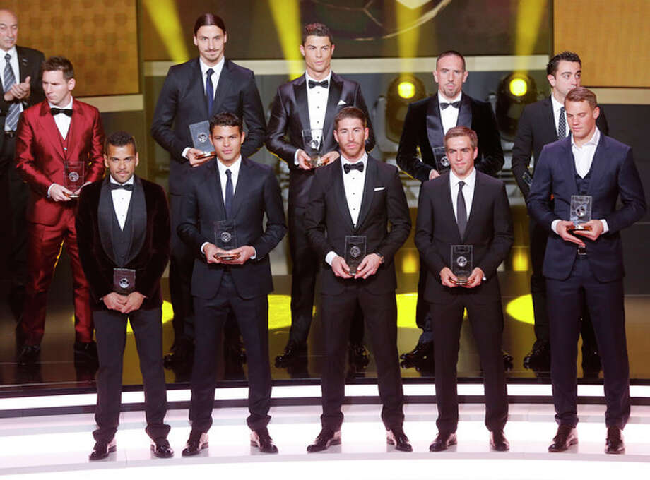 "The FIFA ""dream team"" with the best goal keeper, defenders, midfielders and forwards stands on the stage at the FIFA Ballon d'Or 2013 Gala in Zurich, Switzerland, Monday, Jan. 13, 2014. (AP Photo/Michael Probst) Front row from left: Daniel Alves, Barcelona and Brazil, Thiago Silva, Paris Saint-Germain and Brazil, Sergio Ramos, Real Madrid and Spain, Philipp Lahm, Bayern Munich and Germany, Manuel Neuer, Bayern Munich and Germany, back row from left: Lionel Messi, Barcelona and Argentina, Zlatan Ibrahimovic, Paris Saint-Germain, Cristiano Ronaldo, Real Madrid and Portugal, Franck Ribery, Bayern Munich and Germany and Xavi Hernandez, Barcelona and Spain. / AP"