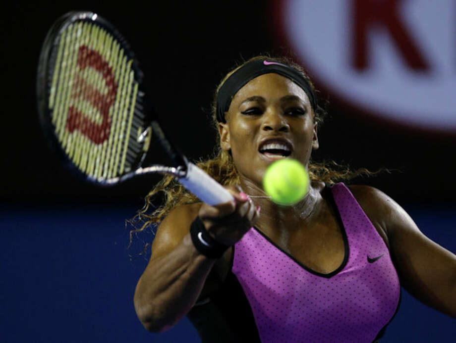 Serena Williams of the United States hits a forehand return to Ashleigh Barty of Australia during their first round match at the Australian Open tennis championship in Melbourne, Australia, Monday, Jan. 13, 2014.(AP Photo/Aaron Favila) / AP