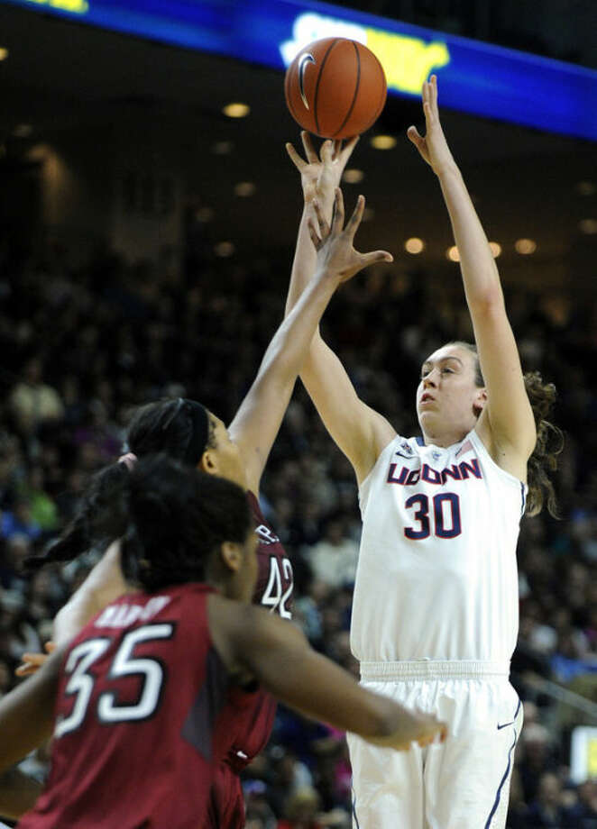 Connecticut's Breanna Stewart (30) shoots over Temple's Taylor Robinson (42) during the second half of Connecticut's 80-36 victory in an NCAA college basketball game in Bridgeport, Conn., Saturday, Jan. 11, 2014. (AP Photo/Fred Beckham)