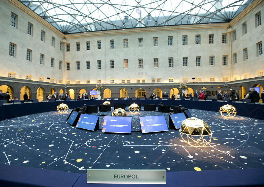 View of the conference room and the seat of Europol director Rob Wainwright at the Maritime museum prior to an informal meeting of EU Justice and Home Affairs ministers at the Maritime Museum in Amsterdam, Netherlands, Monday, Jan. 25, 2016. European Union justice and interior ministers have started urgent discussions on how to tackle the migrant crisis amid the stream of new arrivals and continuing disagreements over how to seal off borders. (AP Photo/Peter Dejong)
