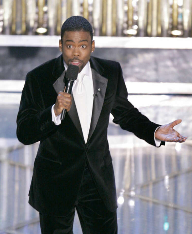 FILE - In this Feb. 27, 2005 file photo, Chris Rock hosts the 77th Academy Awards telecast in Los Angeles. Rock will return to host the Oscars for a second time. Rock, who will return to host the 88th Academy Awards on Feb.28, has made no decisions about his opening monologue. Rock's publicist, in a statement Monday, refuted earlier comments by Academy Awards co-producer Reginald Hudlin that Rock had scraped earlier plans and was rewriting the show following the backlash to the entirely white acting nominees. (AP Photo/Mark J. Terrill, File)