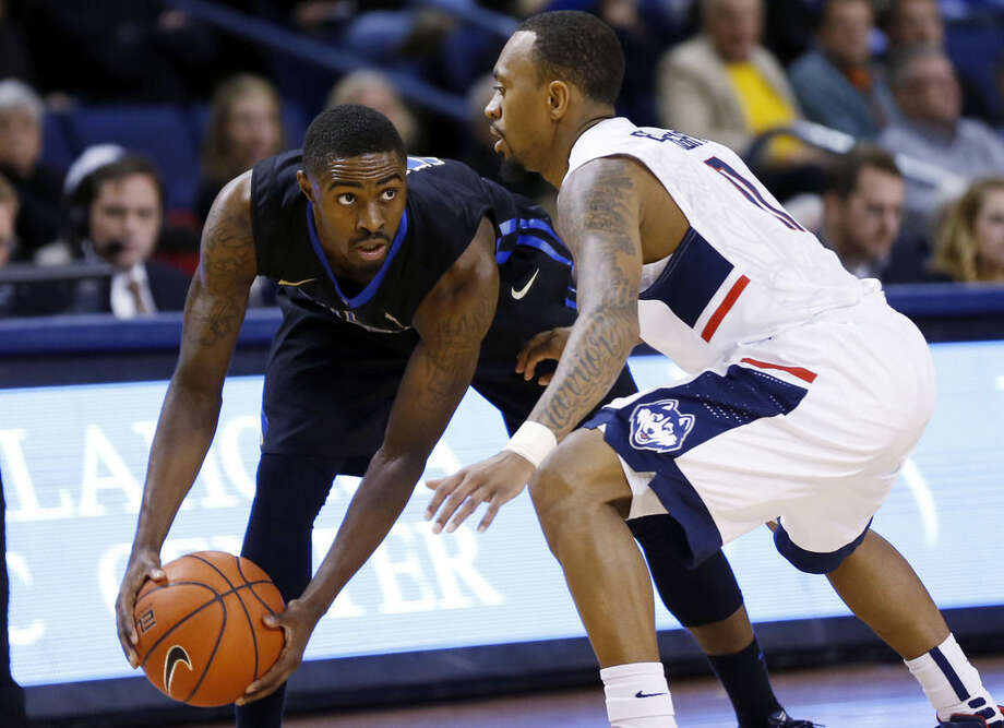 Tulsa's Rashad Ray, left, tries to get around UConn's Ryan Boatright during Tulsa's 66-58 win in an NCAA college basketball game at the Reynolds Center in Tulsa, Okla. on Tuesday, Jan. 13, 2015. (AP Photo/Tulsa World, Cory Young)