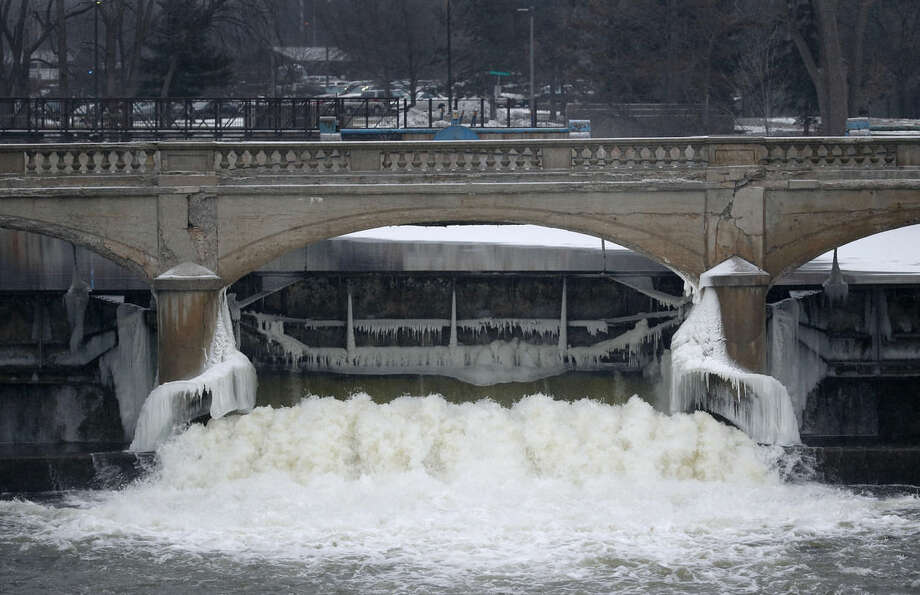 """FILE - In this Jan. 21, 2016, file photo, the Flint River is shown near downtown Flint, Mich. Flint's water became contaminated with lead when the city switched from the Detroit municipal system and began drawing from the Flint River in April 2014 to save the financially struggling city money. Darnell Earley didn't come up with that plane, which caused a health emergency. And he certainly can't be blamed for the Detroit school system's decaying facilities and wrecked finances, which have prompted teacher boycotts this month. But the 64-year-old budget expert was in charge of Flint's city government and the Detroit schools at key points in their recent turmoil, and that has made him a focal point of anger about Gov. Rick Snyder's use of """"emergency managers"""" to temporarily run public entities in Michigan that are hopelessly in debt. (AP Photo/Paul Sancya, File)"""