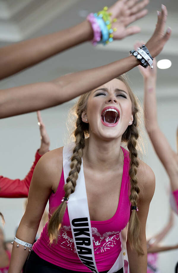 Miss Universe contestant Diana Harkusha of Ukraine participates in a Zumba Class for the contestants, Tuesday, Jan. 13, 2015 in Doral, Fla. The Miss Universe pageant will be held Jan. 25, in Miami. (AP Photo/Wilfredo Lee)