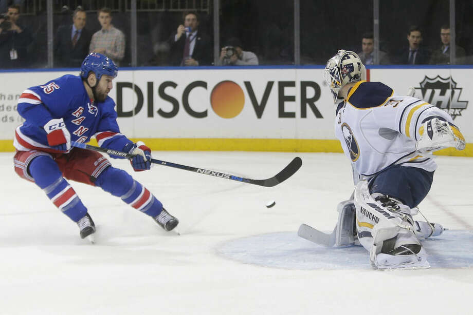 Buffalo Sabres goalie Chad Johnson (31) stops a shot on the goal by New York Rangers' Tanner Glass (15) during the second period of an NHL hockey game, Monday, Jan. 25, 2016, in New York. (AP Photo/Frank Franklin II)