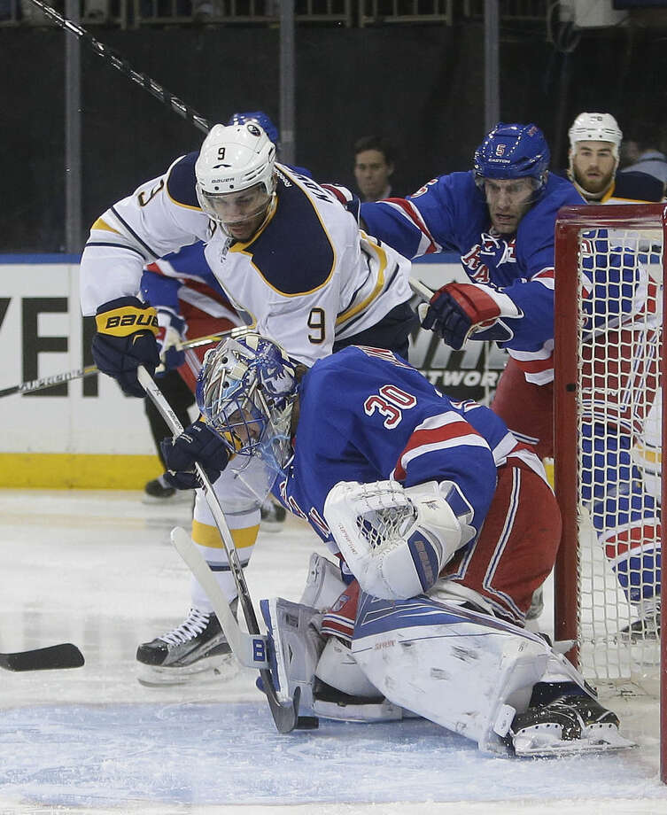 New York Rangers goalie Henrik Lundqvist (30) stops a shot on the goal by Buffalo Sabres' Evander Kane (9) during the first period of an NHL hockey game Monday, Jan. 25, 2016, in New York. (AP Photo/Frank Franklin II)