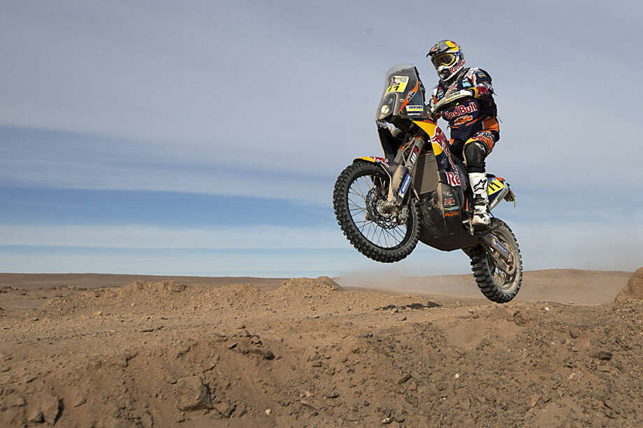 KTM rider Ruben Faria, from Portugal, races during the ninth stage of the Dakar Rally 2015 between the cities of Iquique and Calama, Chile, Tuesday, Jan. 13, 2015. The race will finish on Jan. 17, passing through Bolivia and Chile before returning to Argentina where it started. (AP Photo/Felipe Dana)