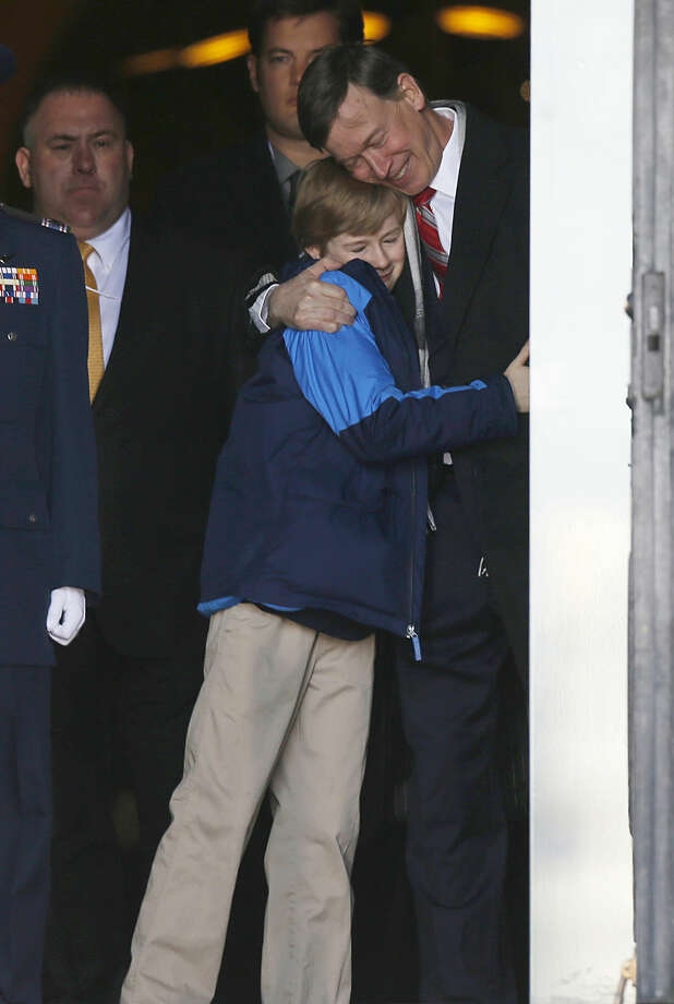 Teddy Hickenlooper hugs his father, Colorado Gov. John Hickenlooper, as the two prepare to step out of the State Capitol before the governor was sworn in for his second term, Tuesday, Jan. 13, 2015, in Denver. (AP Photo/David Zalubowski)