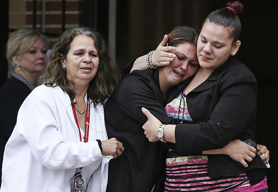 Mourners exit the church after memorial services for 5-year-old Phoebe Jonchuck at Lake Magdalene Methodist Church in Tampa, Fla., on Wednesday, Jan. 14, 2015. Police say Phoebe, 5, died last week at the hands of her father, John Jonchuck Jr., who dropped the little girl from a bridge. She was found dead hours later about a mile away. A St. Petersburg police officer followed Jonchuck for speeding near the Sunshine Skyway bridge and saw him drop the girl into Tampa Bay. Jonchuck fled, but was later arrested and remains jailed on a first-degree murder charge. (AP Photo/The Tampa Bay Times, Eve Edelheit)