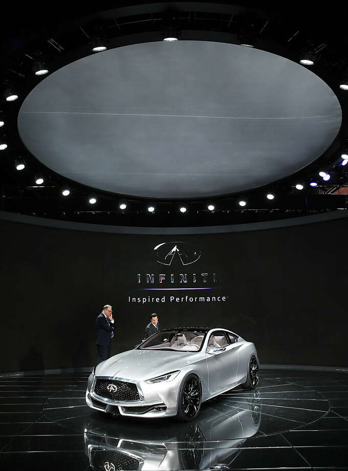 The Infiniti Q60 concept is on display during media previews for the North American International Auto Show in Detroit, Tuesday, Jan. 13, 2015. (AP Photo/Paul Sancya)