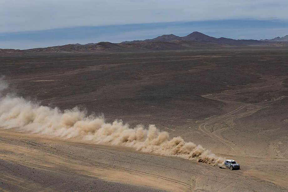 Mini driver Krzysztof Holowczyc, from Poland, and co-pilot Xavier Panseri, from France, race during the ninth stage of the Dakar Rally 2015 between the cities of Iquique and Calama, Chile, Tuesday, Jan. 13, 2015. The race will finish on Jan. 17, passing through Bolivia and Chile before returning to Argentina where it started. (AP Photo/Felipe Dana)