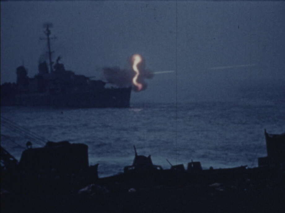 AP photoThis photo shows a scene from the Battle of Iowa Jima, recorded by the U.S. Marine Corps in 1945, and is part of a collection of silent, color films being preserved by the Moving Image Research Collections.