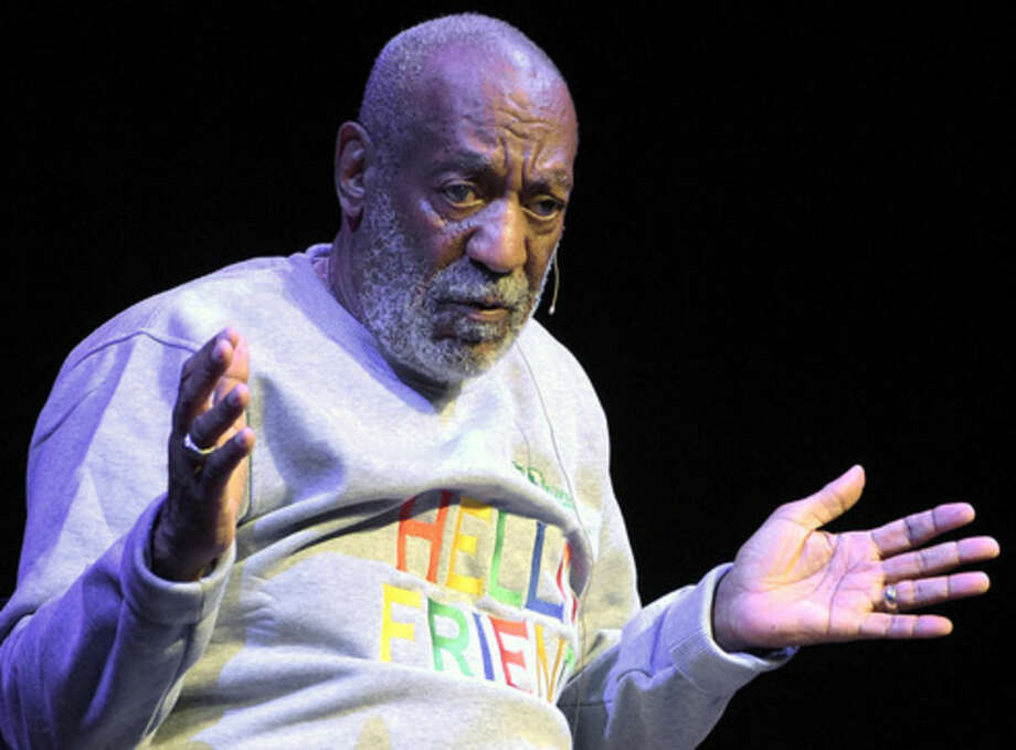 FILE - In this Nov. 21, 2014 file photo, comedian Bill Cosby performs during a show at the Maxwell C. King Center for the Performing Arts in Melbourne, Fla. Sexual assault allegations against Cosby are making it increasingly difficult for locals in a quaint western Massachusetts town to ignore their most famous resident, even if they try. Some shop owners in downtown Shelburne Falls say they're weary of answering questions about the 78-year-old comedian, who they say never frequented their stores anyway. (AP Photo/Phelan M. Ebenhack, File)