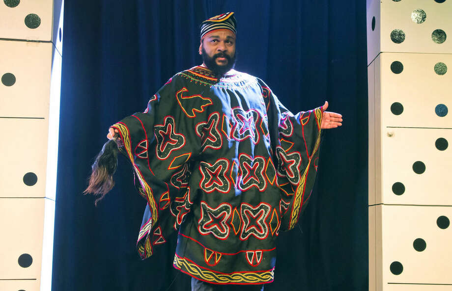 FILE - In this Jan. 11, 2014 file photo, French comedian Dieudonne M'Bala M'Bala arrives for his press conference in a theater in Paris, France. Dieudonne, who popularized an arm gesture that resembles a Nazi salute and who has been convicted repeatedly of racism and anti-Semitism, was in detention Wednesday, Jan. 14, 2015 after posting comments on Facebook — since deleted — that seemed to support the attackers who left 17 dead in the Paris region. (AP Photo/Michel Euler, File)
